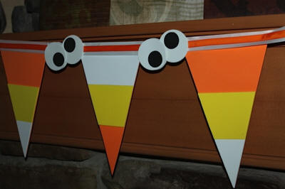 Candy Corn Garland with Googly Eyes on Mantel